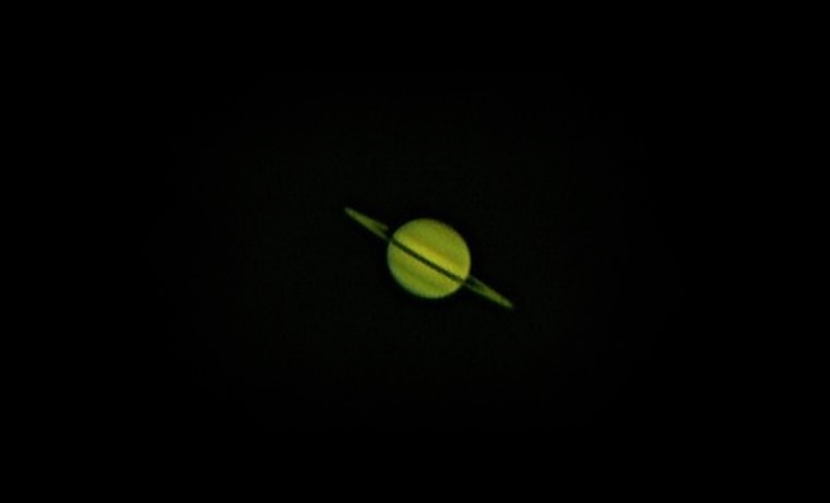 This photo of Saturn was imaged with 2,800 individual frames stacked with Registax, using a webcam and telescope.