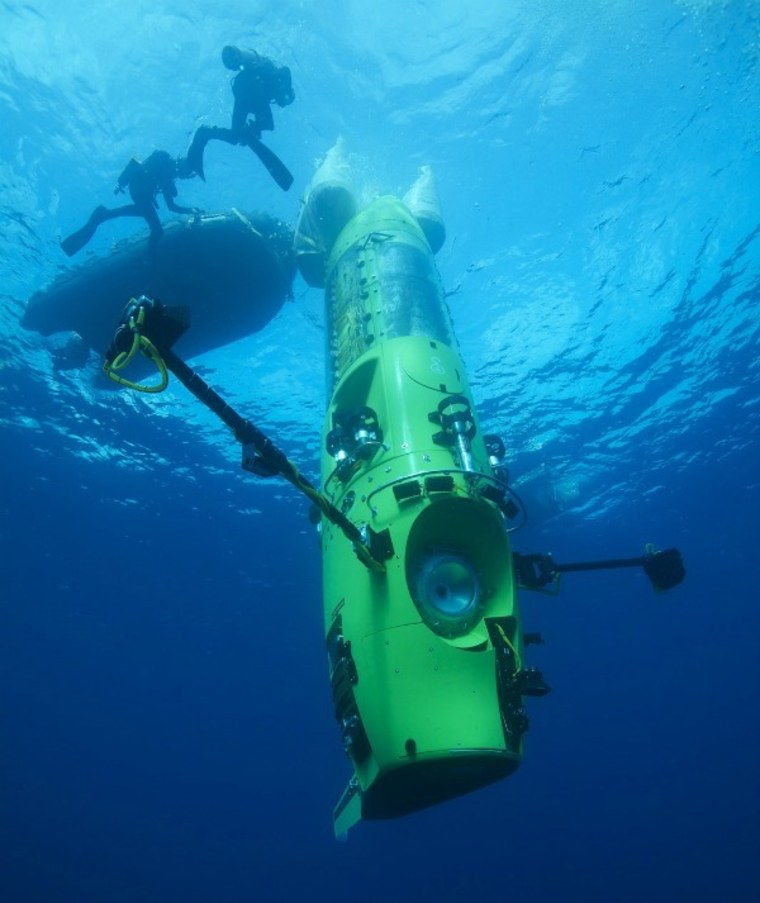The Deepsea Challenger submersible begins its first 2.5-mile (4-km) test dive off the coast of Papua New Guinea. The sub is the centerpiece of Deepsea Challenge, a joint scientific project by explorer and filmmaker James Cameron, the National Geographic Society and Rolex to conduct deep-ocean research.