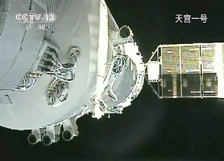 Thisstill photo taken from a video shows China's Shenzhou 8 spacecraft docked with the Tiangong 1 lab module on Nov. 3, 2011.
