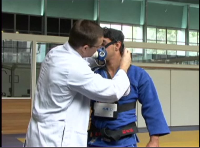Judo practitioners (shown here in still photo from demonstration video) wore portable gas analyzers, which looked a bit like gas masks, as well as mini-jetpacks for the study.