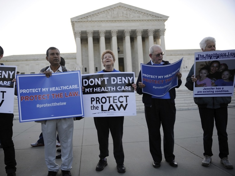 Image: Healthcare law supporters rally on the sidewalk outside ongoing legal arguments over the Patient Protection and Affordable Care Act at the Supreme Court in Washington
