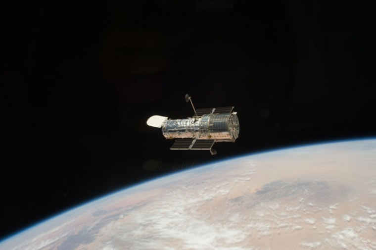 The Hubble Space Telescope got one last overhaul in May 2009 by NASA astronauts on the space shuttle Atlantis and has been sending home stunning photos ever since. Seen here, the iconic space telescope orbits high above Earth, after it was released at the close of the STS-125 servicing mission to once more gaze deep into the universe.