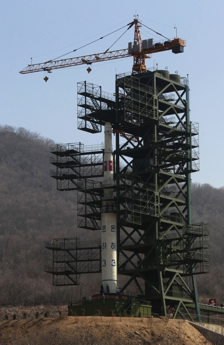 Image: The Unha-3 (Milky Way 3) rocket is pictured on a launch pad at the West Sea Satellite Launch Site during a guided media tour by North Korean authorities in the northwest of Pyongyang