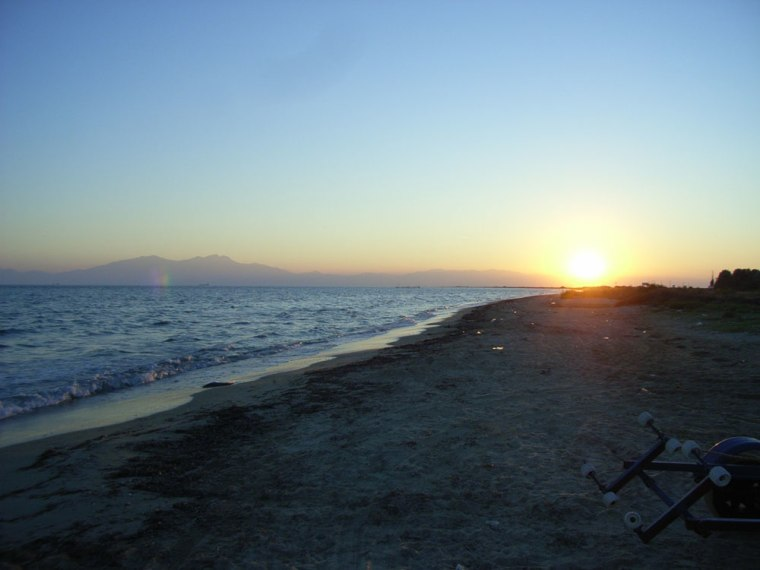 The sun sets over the Greek peninsula of Kassandra, where scientists conducted fieldwork. Mount Olympus looms in the distance.