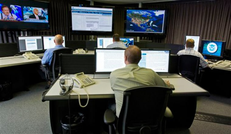 """Cyber security analysts work in the """"watch and warning center"""" at the federal government's secretive cyber defense lab in Idaho Falls, Idaho."""