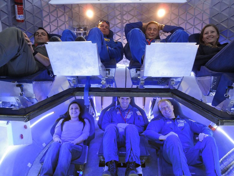 Astronauts and experts check out the crew accommodations in SpaceX's Dragon spacecraft. On top, from left, are NASA Crew Survival Engineering Team Lead Dustin Gohmert, NASA astronauts Tony Antonelli and Lee Archambault, and SpaceX Mission Operations Engineer Laura Crabtree. On bottom, from left, are SpaceX Thermal Engineer Brenda Hernandez and NASA astronauts Rex Walheim and Tim Kopra.