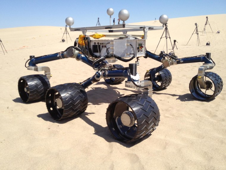 A mockup of NASA's Curiosity Mars rover gets its wheels dirty in sand dunes near California's Death Valley in early May.