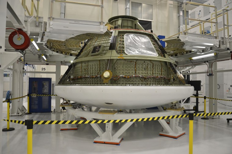 Ground test version of the Orion multi-purpose crew vehicle (MPCV) inside the Operations and Checkout building at NASA's Kennedy Space Center in Florida. The capsule is being used to ready the facility for the arrival of the first MPCV that will fly into space.
