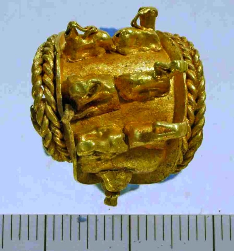 This is the gold earring found at Tel Megiddo.
