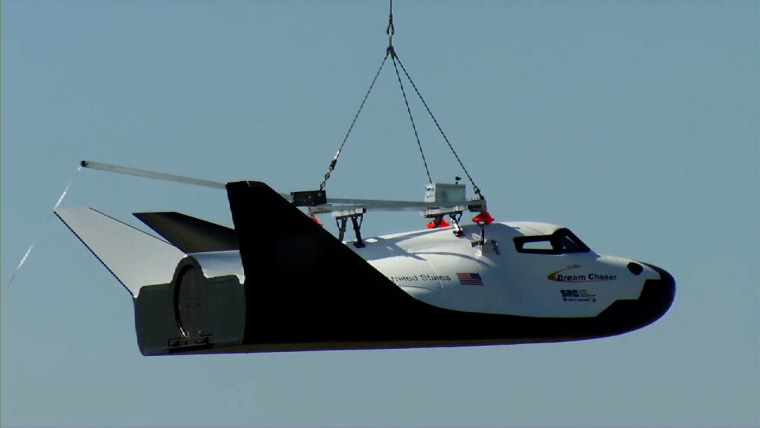 Sierra Nevada Corp. Space Systems' Dream Chaser flight vehicle is lifted by an Erickson Air-Crane helicopter near the Rocky Mountain Metropolitan Airport in Jefferson County, Colo., on May 29, during a captive-carry test.
