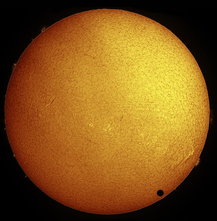 Paul Hyndman captured this stunning view of Venus crossing the face of the sun in hydrogen-alpha light on the morning of June 8, 2004 from Roxbury, Conn. He used an Astro-Physics 105-millimeter Traveler telescope fitted with a Coronado Solarmax90/T-Max and 30-mm blocking filter, a TeleVue 2X Powermate lens, and an SBIG STL-11000M CCD camera.