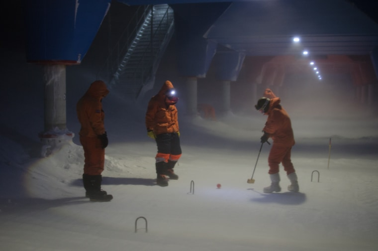 The staff that is wintering over at the British Antarctic Survey's Halley station plays a round of outdoor croquet in 40-mph winds and freezing temperatures to celebrate the Queen's Diamond Jubilee.