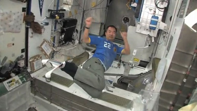 Japanese astronaut Soichi Noguchi kicks up his heels — and his skis — during a makeshift Winter Olympics event aboard the International Space Station in February 2010. NASA's shuttle Endeavour was docked at the station during the 2010 Winter Olympics in Vancouver, B.C., Canada during its STS-130 mission.