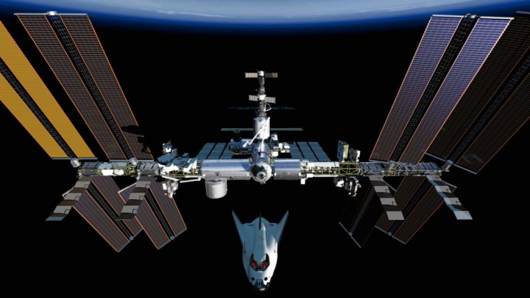 An artist's rendering of Dream Chaser approaching the International Space Station.