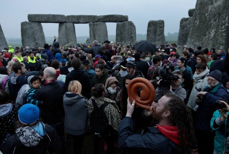 People gathered during the summer solstice at Stonehenge, near Salisbury, onThursday. Crowds were welcomed by atypical British rainy summer day.