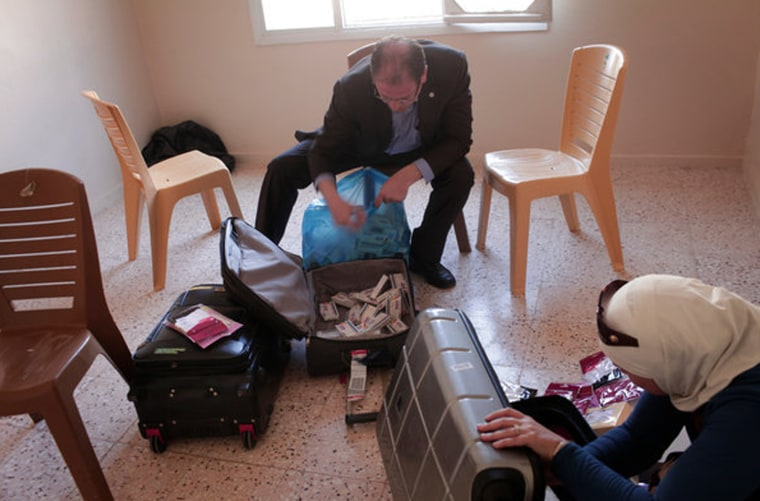 Organizing medical supplies bound for makeshift field hospitals in Syria, the opposition undertaking here constitutes more than just ferrying much needed supplies. The larger, more elusive goal is to create cohesion and cooperation between the scattered militias that constitute the Free Syrian Army, as well as whatever local civilian rule has emerged.