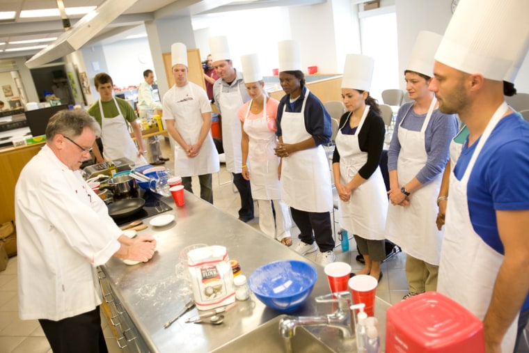 """During their mission, the """"astronauts"""" will not only take detailed surveys on all their meals, but will pursue space mission-related research of their own. Here, Rupert Spies, senior lecturer in Food and Beverage Management (HFO), gives a hands-on workshop on bread making with the NASA team."""
