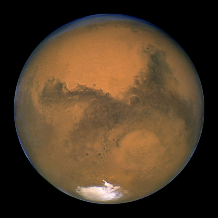 NASA's Hubble Space Telescope snapped this shot of Mars on Aug. 26, 2003, when the Red Planet was 34.7 million miles from Earth. Hydrothermal systems there could provide oases for life forms.