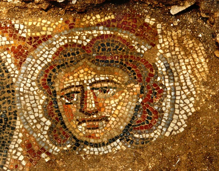 A female face depicted in a mosaic on an ancient Jewish synagoge. Archaeologists uncovered this high-quality artwork in June.