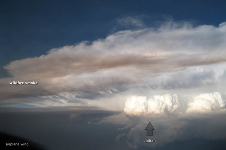 A dramatic photo captured by a NASA scientist on June 22 shows smoke being sucked into a thunderstorm.