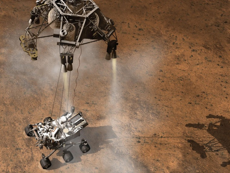 This artist's concept depicts the Sky Crane lowering NASA's Curiosity rover onto the Martian surface.