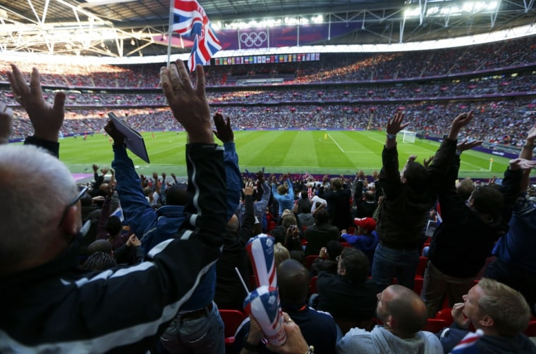 Image: Britain's supporters watch their men's preliminary first round Group A soccer match against UAE at the London 2012 Olympic Games in the Wembley Stadium in London
