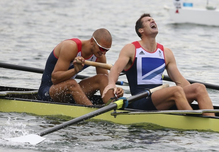 Image: Great Britain's Mohamed Sbihi (L) and Greg Searle (R) after the Men's Eight final during the London 2012 Olympic Games