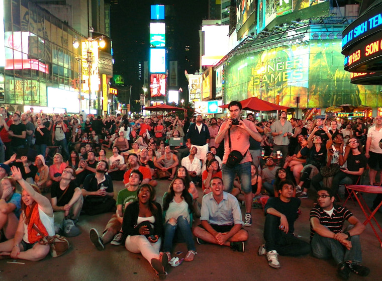 About 1,000 people watch NASA's Curiosity rover land on Mars from New York City's Times Square on Sunday.