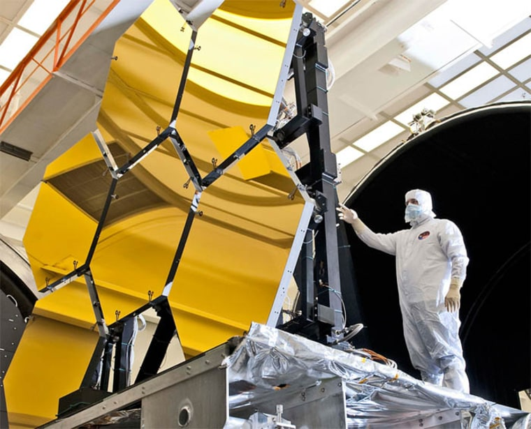 An engineer inspects the JWST's primary mirror segments at NASA's Marshall Space Flight Center in Huntsville, Ala.