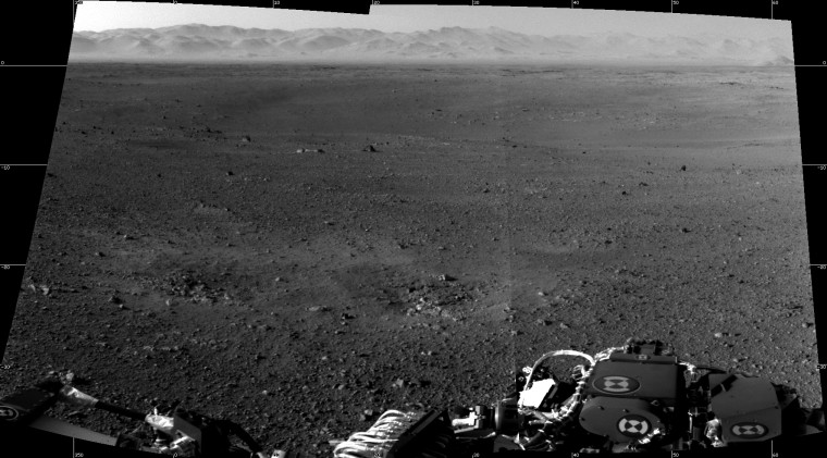 """These are the first two full-resolution images of the Martian surface from the Navigation cameras on NASA's Curiosity rover, which are located on the rover's """"head"""" or mast. The rim of Gale Crater can be seen in the distance beyond the pebbly ground."""