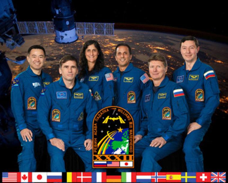 Pictured from the left are Flight Engineers Akihiko Hoshide, Yuri Malenchenko, Sunita Williams and Joe Acaba, Commander Gennady Padalka and Flight Engineer Sergei Revin.