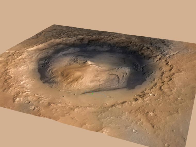 NASA's Curiosity rover landed in the Martian crater known as Gale Crater, which is about the size of Connecticut and Rhode Island combined. A green dot shows where the rover landed, well within its targeted landing ellipse, outlined in blue. This image was released on Tuesday.