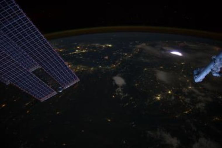 A sprite glows brilliantly at the rightin this image captured by astronauts on the space station on April 30.