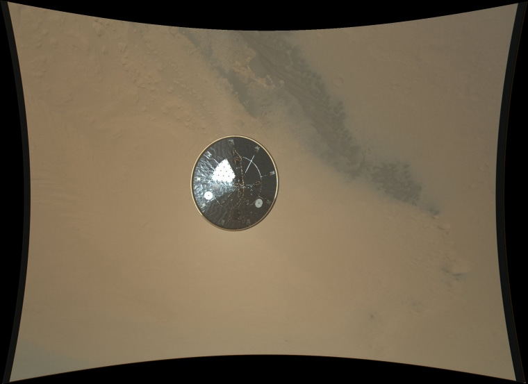This color full-resolution image showing the heat shield of NASA's Curiosity rover was obtained during descent to the surface of Mars on Aug. 5 PDT (Aug. 6 EDT). The 15-foot heat shield was photographed by Curiosity's MARDI descent camera.