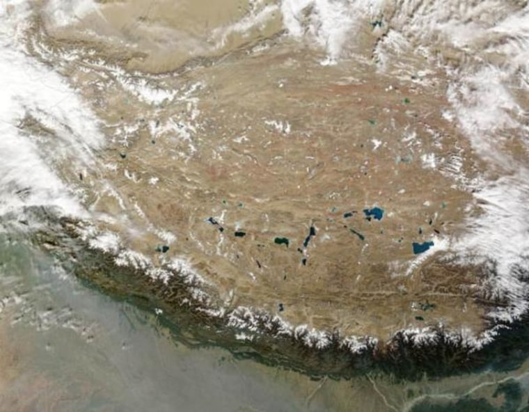 What's going on under there? The whole of the Tibetan Plateau, in true color, captured by satellite. The Himalayas can be seen along the bottom edge of the image.
