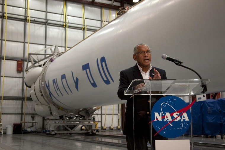 Image: NASA Administrator Charles Bolden stands next to SpaceX's Falcon 9 launch vehicle as he speaks to the media at Kennedy Space Center in Cape Canaveral