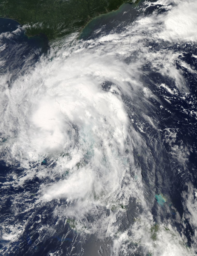 NASA's Aqua satellite passed over Tropical Storm Isaac on Sunday at 2:15 p.m. EDT. When it was over Florida and Cuba,the MODIS instrument captured this visible image of the storm.