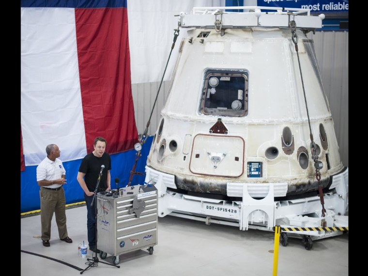 NASA Administrator Charles Bolden, left, and SpaceX Chief Executive Officer Elon Musk view the historic Dragon capsule that returned to Earth on May 31 following the first successful mission by a private company to carry supplies to the International Space Station. This picture was taken June 13, 2012 at a SpaceX facility in McGregor, Texas.