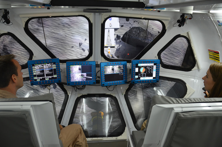 Scientist Liz Rampe and flight controller David Coan pilot NASA's multi-mission Space Exploration Vehicle (SEV) during an asteroid mission simulation at the Johnson Space Center in Houston on Thursday.