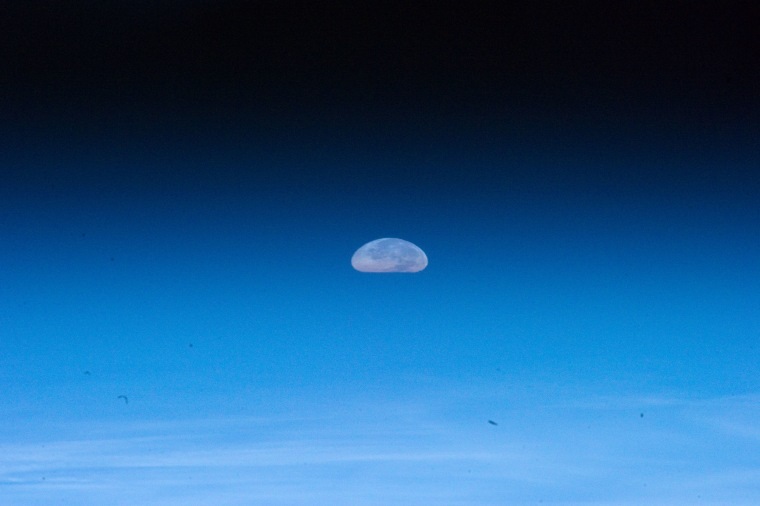 The Aug. 1 full moon appears squashed due to distortions by Earth's atmosphere in this photo by an astronaut on the International Space Station.