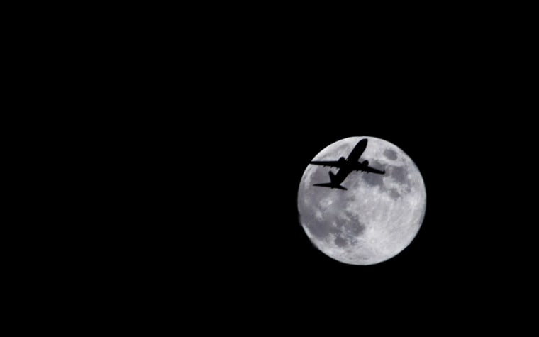 Photographer Sid Vedula captured this amazing view of the full moon of Aug. 1 from Houston, Texas with a passing airplane in silhouette.