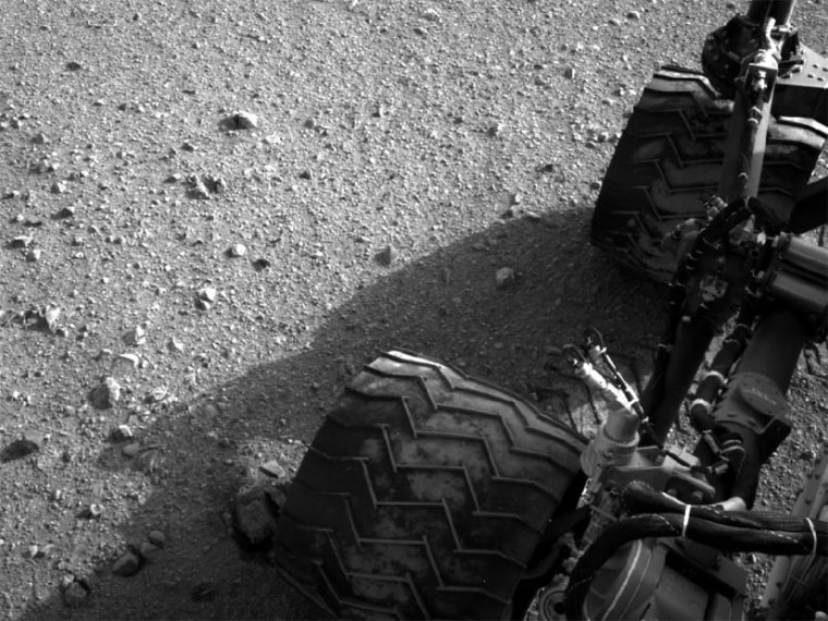Mars rover Curiosity captured this Navcam photo of its right rear and middle wheel on sol 22 of the mission. Dust from its third drive can be seen onthe wheels' treads.
