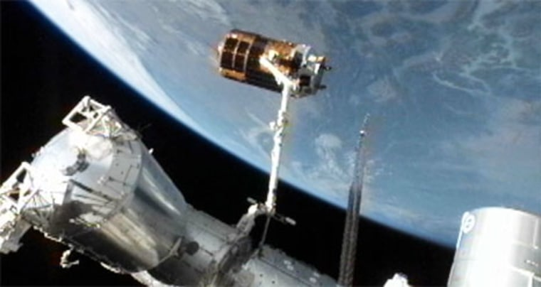Japan's unmanned HTV-3 cargo ship is perched at the end of the International Space Station's robotic arm before its release on Wednesday to end its delivery mission.