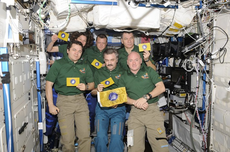 International Astronautical Federation flags seen aboard the International Space Station during their first spaceflight with the Soyuz TMA-20 and Expedition 26 crews.