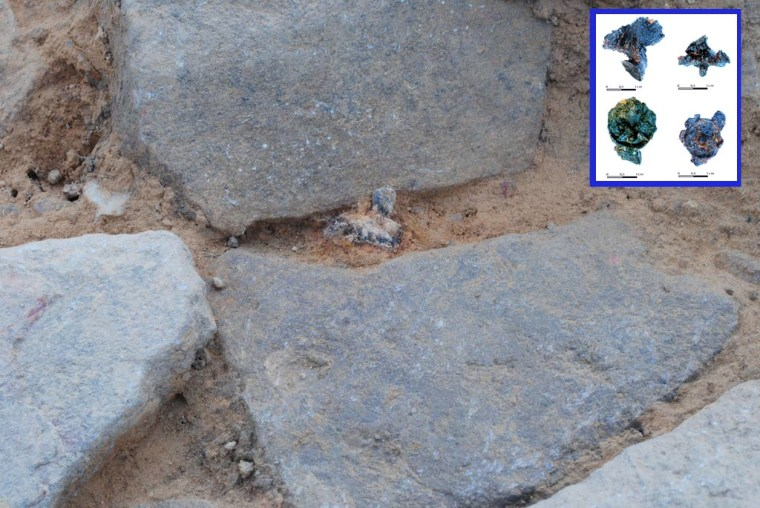 A view of paving stones discovered at the Roman military camp at Hermeskeil in Germany; a shoe nail from a Roman soldier can be seen between the stones (shoe nails shown in inset).