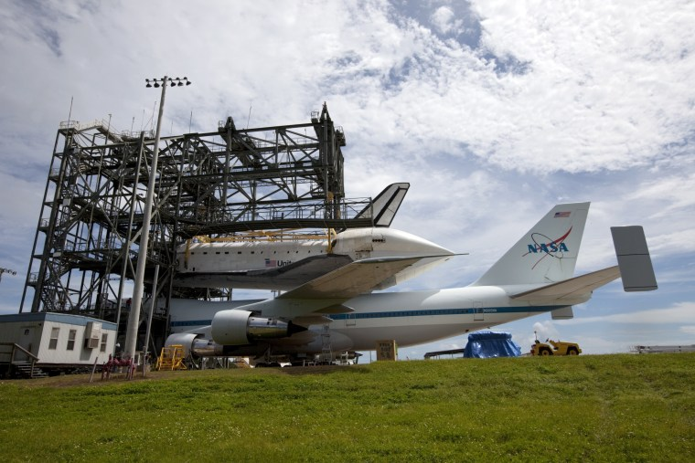 The space shuttle Endeavour is lowered onto the Shuttle Carrier Aircraft at the Shuttle Landing Facility at NASA's Kennedy Space Center in Florida.