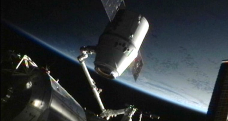 SpaceX's Dragon space capsule is detached from its docking port on the International Space Station on May 31 ahead of the spacecraft's return to Earth to end its first voyage to the orbiting lab.