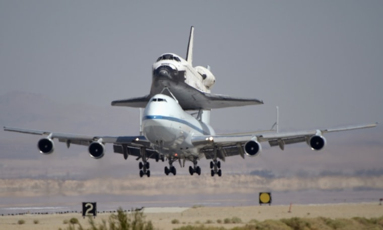 Image: The space shuttle Endeavour atop Boeing 747 jumbo jet lands at Edwards Air Force Base in California