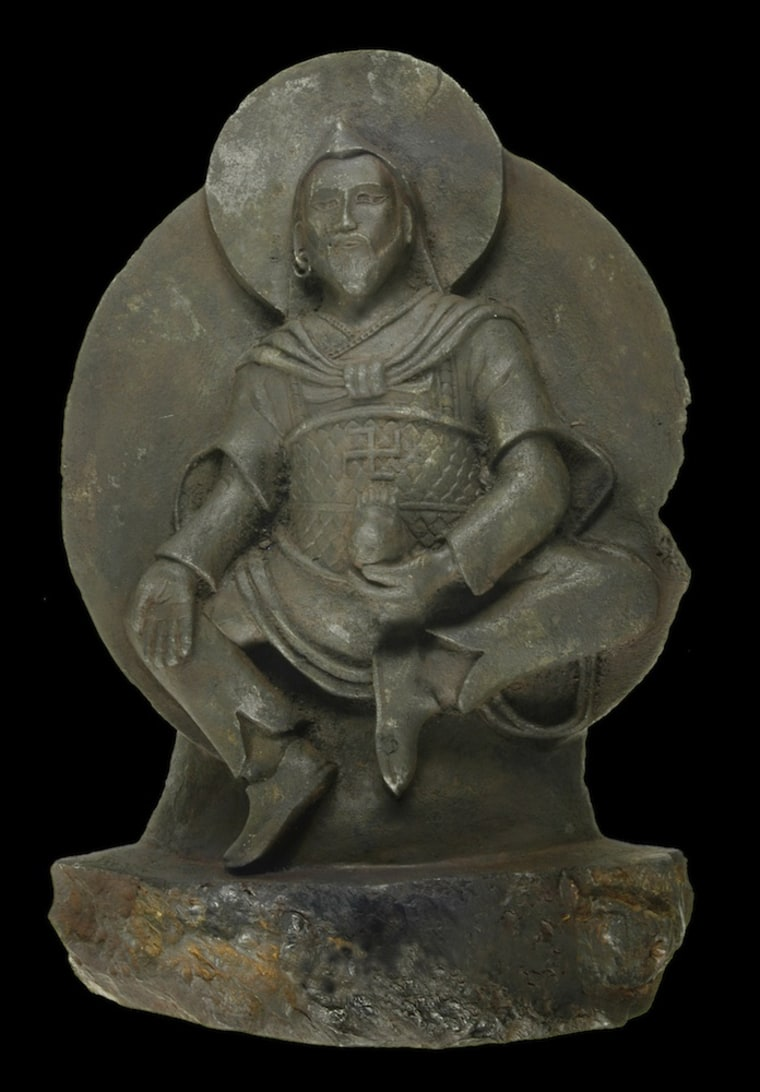 A Buddha statue dating back to the eighth to 10th centuries is carved from a rare iron meteorite.