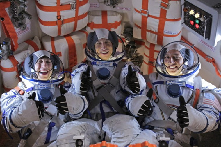 """Veteran NASA astronaut Mike Massimino (right) poses for a photo with Big Bang Theory actor Simon Helberg and another actor during a break from filming the season finale of CBS' """"Big Bang Theory."""""""